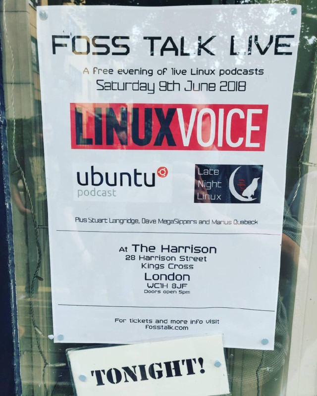 The poster for FOSS Talk Live 2018, in situ in the window of the Harrison
