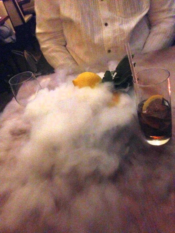 Dry ice clouds boiling all over our table